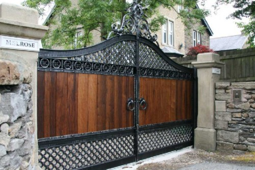 New unique wooden gates with wrought iron driveway gates for Wooden driveway gates designs