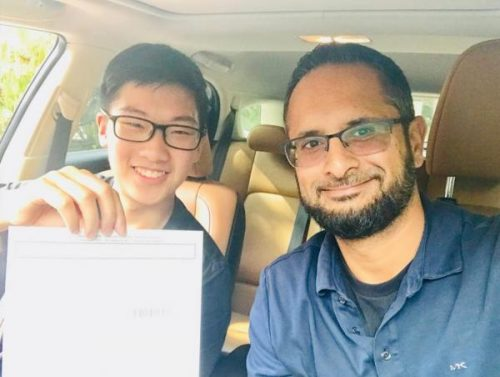 Shayraz Khan and a Tomorrow's Drivers student who just passed his road test